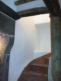 lime plastered stairwell painted with breathable paint