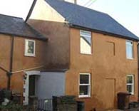 lime rendered house painted with cob coloured limewash