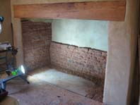 lime plastered and repointed fireplace